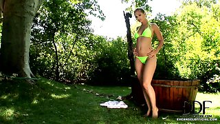 Eve Angel in bath outdoors