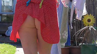 Red dress no knickers spare pegs hanging washing