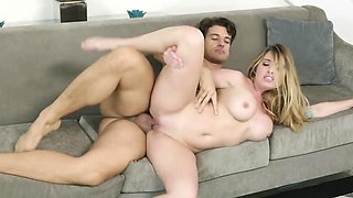 Busty tattooed blonde gets ravaged on the sofa