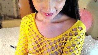 Attractive brunette in fishnets shows off her huge nipples
