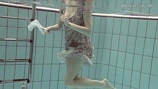 Cute European teenie caught on cam in the pool underwater