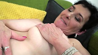 Short haired mature is in black stockings and up for some fun