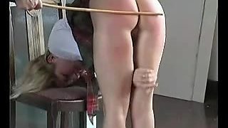Nice looking schoolgirl gets some bare butt spanking