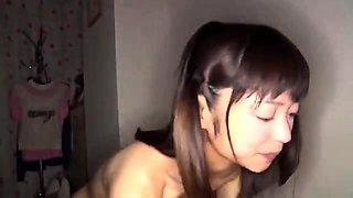 Petite Oriental schoolgirl doesn't shy away from a hard cock