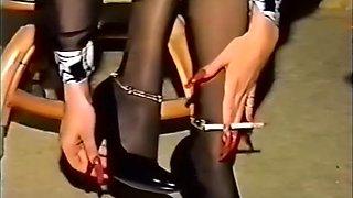 Vintage smoking fetish slut with long red nails & lipstick takes a cumshot