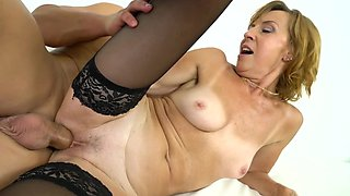 Czech buddy stretches on couch attractive mature woman