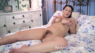 A busty and sexy Cherry Blush strips naked in bed