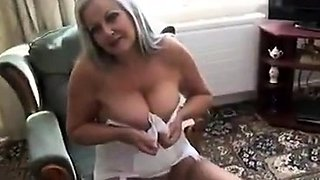 Busty mature lady in stockings shows off her tight pussy