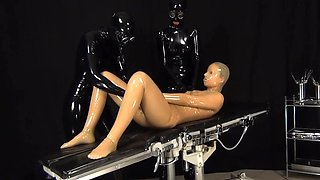 Latex rubber doll in fuck-rubber dress.