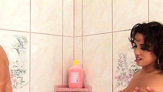 Busty glamour lesbians fingerfuck in shower