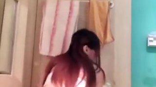 Korean girl striptease selfie in the bathroom