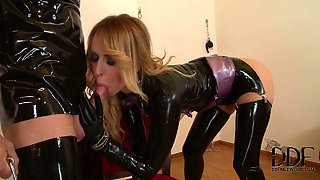 Horny couple in latex suits enjoy hard sex session