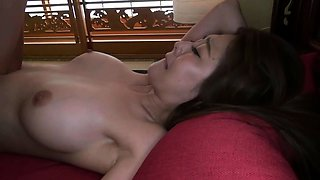 Slender Oriental babe with big tits is craving for hard meat