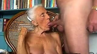 Horny amateur granny with big tits deepthroats a meat pole