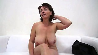 Brunette mature gets completely naked and gets fucked