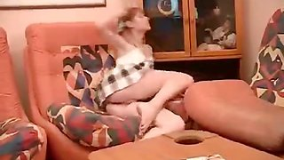 Smiling innocent teen plays with her pussy