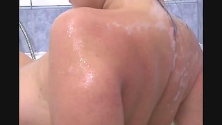 Horny milf rubs her big tits in a soapy bubble bath
