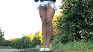 Crossdresser frilly mini skirt pantyhose .