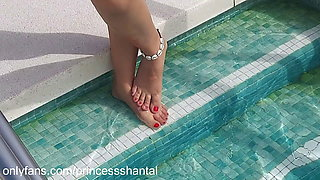 beautiful Latin and hot girl shows her beautiful feet at the pool