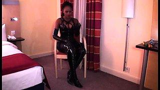Bodacious ebony beauty in latex dominates her masked slave