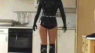 Blonde mistress in latex jerking a male slave