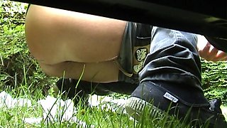 Chubby girl peeing long and hard on the grass