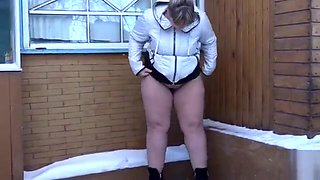Fat Russian bimbo takes a powerful piss in the snow